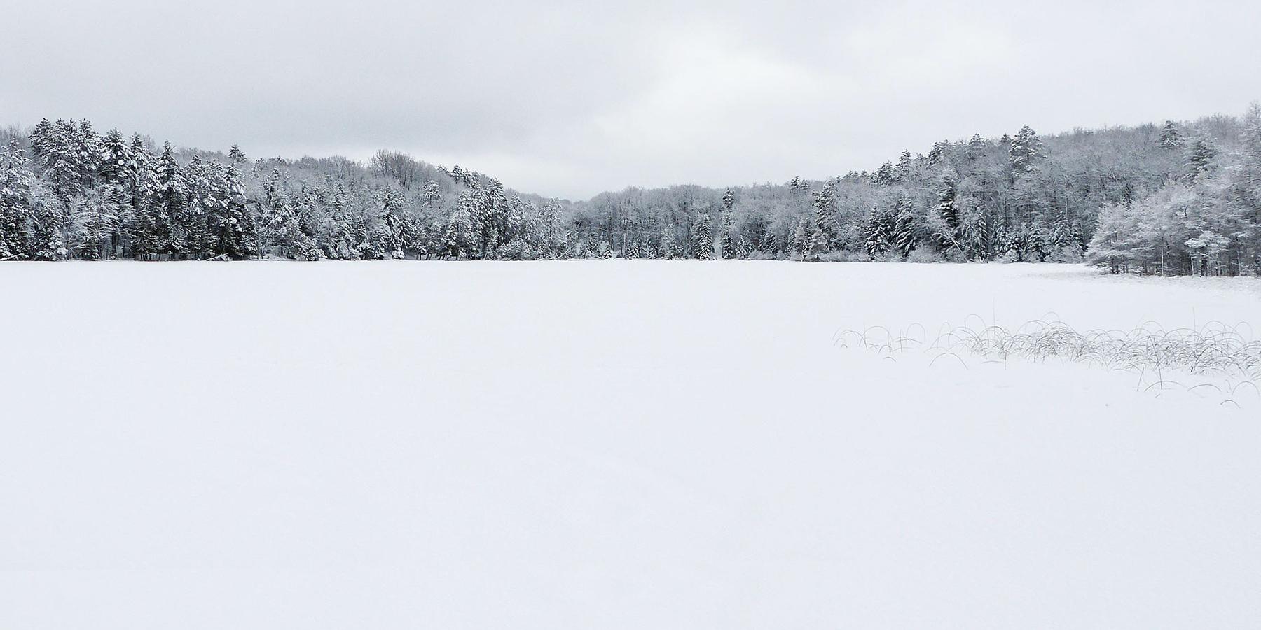 Aerial view of a frozen Shear Lake at Camp Barakel